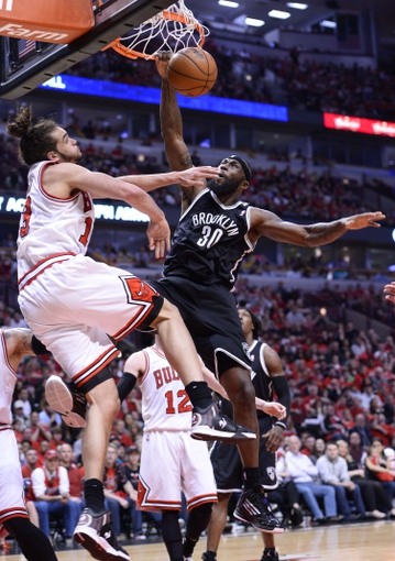 Apr 27, 2013; Chicago, IL, USA; Brooklyn Nets power forward Reggie Evans (30) shoots the ball against Chicago Bulls center Joakim Noah (13) in the second half during game four of the first round of the 2013 NBA playoffs at the United Center. Chicago defeats Brooklyn 142-134 in triple overtime. Mandatory Credit: Mike DiNovo-USA TODAY Sports