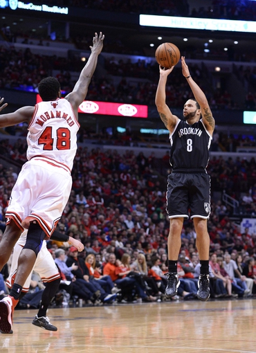 Apr 27, 2013; Chicago, IL, USA; Brooklyn Nets point guard Deron Williams (8) shoots the ball against Chicago Bulls center Nazr Mohammed (48) in the second half during game four of the first round of the 2013 NBA playoffs at the United Center. Chicago defeats Brooklyn 142-134 in triple overtime. Mandatory Credit: Mike DiNovo-USA TODAY Sports