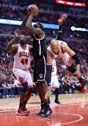 Apr 27, 2013; Chicago, IL, USA; Brooklyn Nets power forward Reggie Evans (30) shoots the ball against Chicago Bulls power forward Taj Gibson (22) in the second half during game four of the first round of the 2013 NBA playoffs at the United Center. Chicago defeats Brooklyn 142-134 in triple overtime. Mandatory Credit: Mike DiNovo-USA TODAY Sports