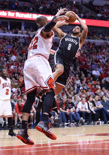 Apr 27, 2013; Chicago, IL, USA; Brooklyn Nets point guard Deron Williams (8) shoots the gall against Chicago Bulls power forward Taj Gibson (22) in the second half during game four of the first round of the 2013 NBA playoffs at the United Center. Chicago defeats Brooklyn 142-134 in triple overtime. Mandatory Credit: Mike DiNovo-USA TODAY Sports