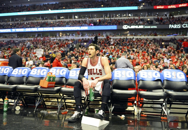 Apr 27, 2013; Chicago, IL, USA; Chicago Bulls shooting guard Kirk Hinrich (12) sits on the bench during a time out against the Brooklyn Nets in the second half during game four of the first round of the 2013 NBA playoffs at the United Center. Chicago defeats Brooklyn 142-134 in triple overtime. Mandatory Credit: Mike DiNovo-USA TODAY Sports