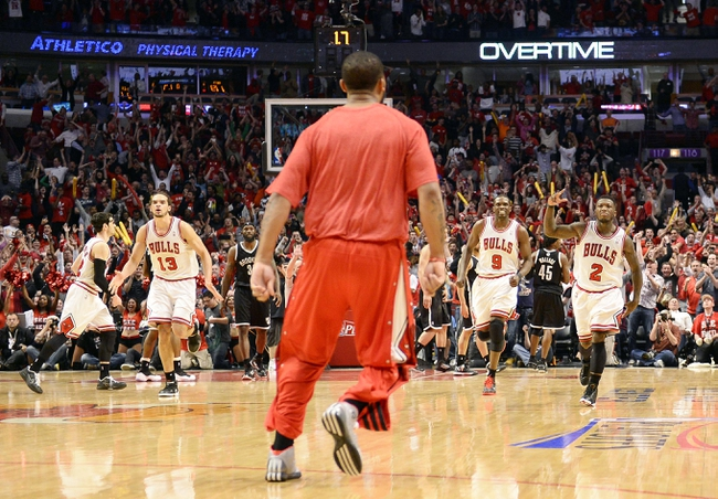 Apr 27, 2013; Chicago, IL, USA; Chicago Bulls point guard Nate Robinson (2) reacts after hitting a shot against the Brooklyn Nets during game four of the first round of the 2013 NBA playoffs at the United Center. Chicago defeats Brooklyn 142-134 in triple overtime. Mandatory Credit: Mike DiNovo-USA TODAY Sports