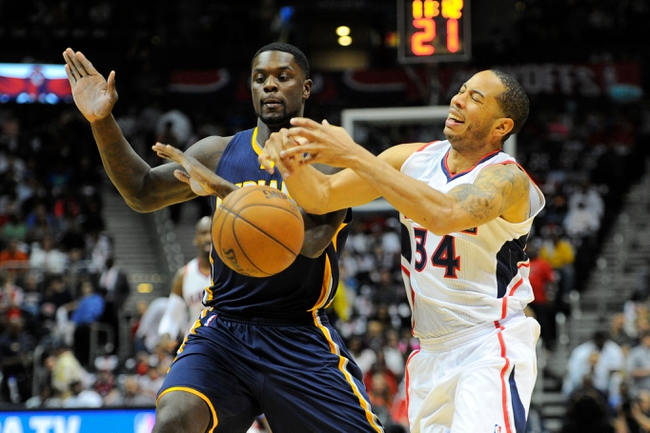 Apr 27, 2013; Atlanta, GA, USA; Indiana Pacers shooting guard Lance Stephenson (1) knocks the ball away from Atlanta Hawks point guard Devin Harris (34) in the first half during game three in the first round of the 2013 NBA playoffs at Philips Arena. Mandatory Credit: Dale Zanine-USA TODAY Sports