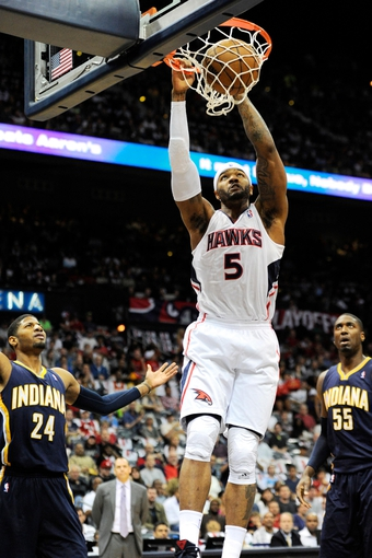 Apr 27, 2013; Atlanta, GA, USA; Atlanta Hawks small forward Josh Smith (5) dunks past Indiana Pacers small forward Paul George (24) in the first half during game three in the first round of the 2013 NBA playoffs at Philips Arena. Mandatory Credit: Dale Zanine-USA TODAY Sports
