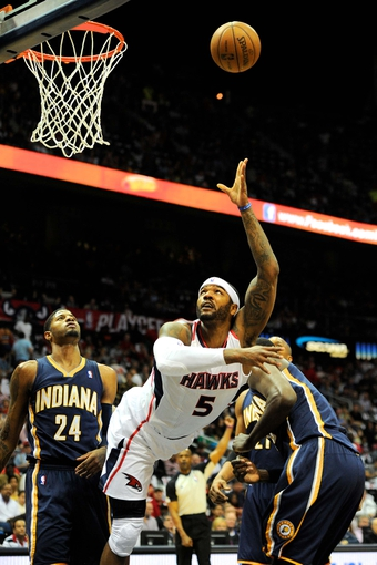 Apr 27, 2013; Atlanta, GA, USA; Atlanta Hawks small forward Josh Smith (5) after driving past Indiana Pacers small forward Paul George (24) in the first half during game three in the first round of the 2013 NBA playoffs at Philips Arena. Mandatory Credit: Dale Zanine-USA TODAY Sports