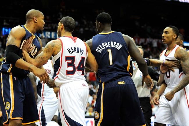 Apr 27, 2013; Atlanta, GA, USA; Indiana Pacers power forward David West (far left) is confronted by Atlanta Hawks point guard Jeff Teague (far right) after fouling Hawks center Al Horford (not shown) from behind in the first half during game three in the first round of the 2013 NBA playoffs at Philips Arena. Mandatory Credit: Dale Zanine-USA TODAY Sports