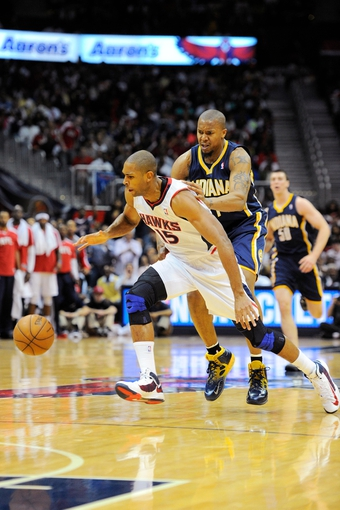 Apr 27, 2013; Atlanta, GA, USA; Atlanta Hawks center Al Horford (15) is fouled from behind by Indiana Pacers power forward David West (21) in the first half during game three in the first round of the 2013 NBA playoffs at Philips Arena. Mandatory Credit: Dale Zanine-USA TODAY Sports