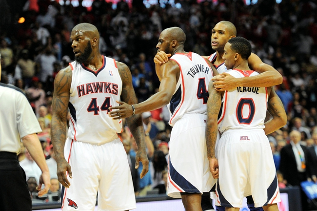 Apr 27, 2013; Atlanta, GA, USA; Atlanta Hawks center Al Horford (second from right) hugs teammates after they responded to a foul against the Indiana Pacers in the first half during game three in the first round of the 2013 NBA playoffs at Philips Arena. Mandatory Credit: Dale Zanine-USA TODAY Sports