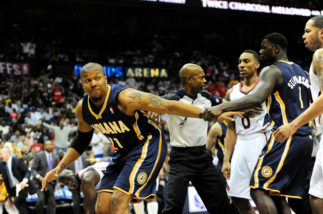 Apr 27, 2013; Atlanta, GA, USA; Indiana Pacers power forward David West (21) is confronted by Atlanta Hawks point guard Jeff Teague (0) after fouling Hawks center Al Horford (not shown) from behind in the first half during game three in the first round of the 2013 NBA playoffs at Philips Arena. Mandatory Credit: Dale Zanine-USA TODAY Sports