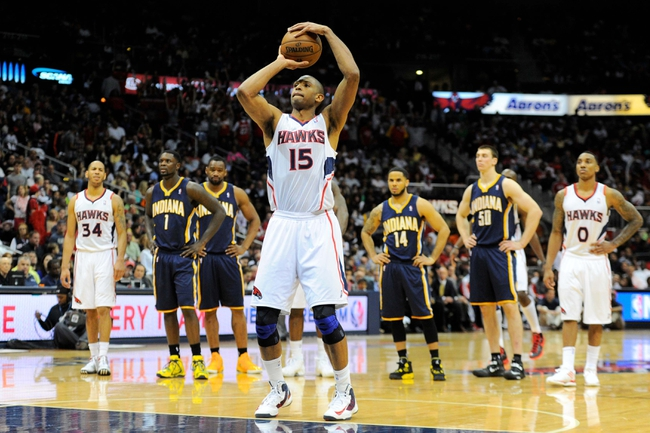 Apr 27, 2013; Atlanta, GA, USA; Atlanta Hawks center Al Horford (15) shoots technical fouls shots against the Indiana Pacers in the first half during game three in the first round of the 2013 NBA playoffs at Philips Arena. Mandatory Credit: Dale Zanine-USA TODAY Sports