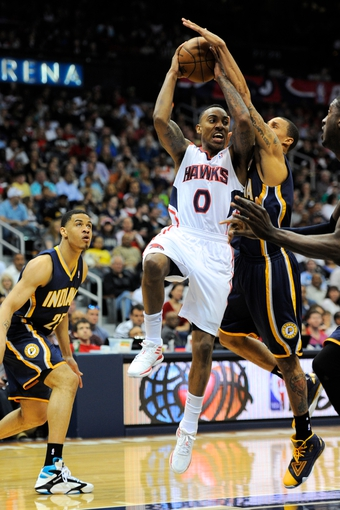 Apr 27, 2013; Atlanta, GA, USA; Atlanta Hawks point guard Jeff Teague (0) is fouled by Indiana Pacers point guard George Hill (3) during the first half during game three in the first round of the 2013 NBA playoffs at Philips Arena. Mandatory Credit: Dale Zanine-USA TODAY Sports