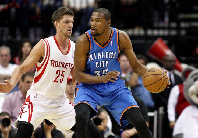 Apr 27, 2013; Houston, TX, USA; Oklahoma City Thunder small forward Kevin Durant (35) controls the ball as Houston Rockets small forward Chandler Parsons (25) defends in the first quarter during game three in the first round of the 2013 NBA playoffs at the Toyota Center. Mandatory Credit: Troy Taormina-USA TODAY Sports