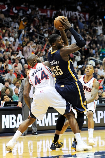 Apr 27, 2013; Atlanta, GA, USA; Indiana Pacers center Roy Hibbert (55) is defended by Atlanta Hawks power forward Ivan Johnson (44) during the second half during game three in the first round of the 2013 NBA playoffs at Philips Arena. The Hawks defeated the Pacers 90-69. Mandatory Credit: Dale Zanine-USA TODAY Sports
