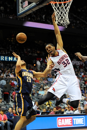 Apr 27, 2013; Atlanta, GA, USA; Indiana Pacers power forward Jeff Pendergraph (29) has his shot blocked by Atlanta Hawks power forward Mike Scott (32) during the second half of game three of the first round of the 2013 NBA playoffs at Philips Arena. The Hawks defeated the Pacers 90-69. Mandatory Credit: Dale Zanine-USA TODAY Sports