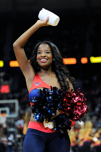 Apr 27, 2013; Atlanta, GA, USA; An Atlanta Hawks cheerleader entertains fans during the second half of game three of the first round of the 2013 NBA playoffs against the Indiana Pacers at Philips Arena. The Hawks defeated the Pacers 90-69. Mandatory Credit: Dale Zanine-USA TODAY Sports