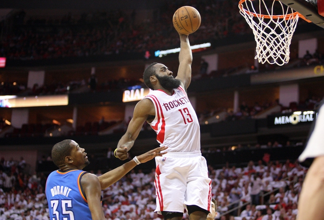 Apr 27, 2013; Houston, TX, USA; Houston Rockets shooting guard James Harden (13) dunks the ball over Oklahoma City Thunder small forward Kevin Durant (35) in the first quarter during game three in the first round of the 2013 NBA playoffs at the Toyota Center. Mandatory Credit: Troy Taormina-USA TODAY Sports