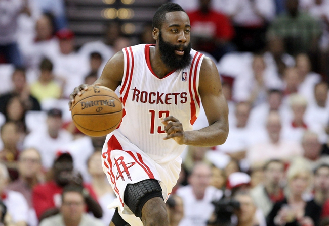 Apr 27, 2013; Houston, TX, USA; Houston Rockets shooting guard James Harden (13) gets the ball on a fast break during the second quarter against the Oklahoma City Thunder during game three in the first round of the 2013 NBA playoffs at the Toyota Center. Mandatory Credit: Troy Taormina-USA TODAY Sports