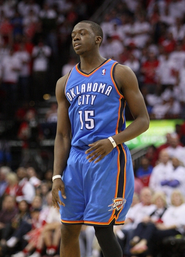 Apr 27, 2013; Houston, TX, USA; Oklahoma City Thunder point guard Reggie Jackson (15) reacts after making a free throw in the fourth quarter against the Houston Rockets in game three of the first round of the 2013 NBA playoffs at the Toyota Center. The Thunder defeated the Rockets 104-101. Mandatory Credit: Troy Taormina-USA TODAY Sports