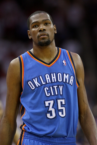 Apr 27, 2013; Houston, TX, USA; Oklahoma City Thunder small forward Kevin Durant (35) reacts after a play during the fourth quarter against the Houston Rockets in game three of the first round of the 2013 NBA playoffs at the Toyota Center. Mandatory Credit: Troy Taormina-USA TODAY Sports