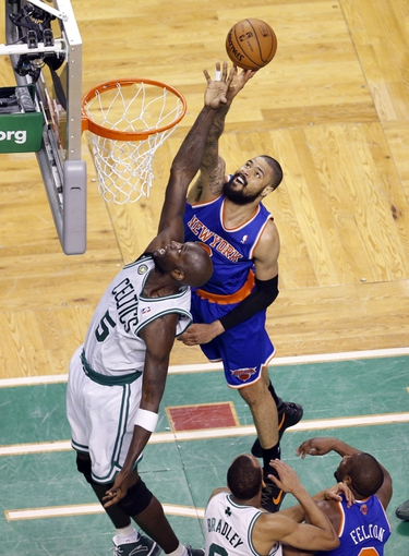 Apr 28, 2013; Boston, MA, USA; New York Knicks center Tyson Chandler (6) works to shoot against Boston Celtics center Kevin Garnett (5) during the third quarter in game four of the first round of the 2013 NBA playoffs at TD Garden. Mandatory Credit: David Butler II-USA TODAY Sports