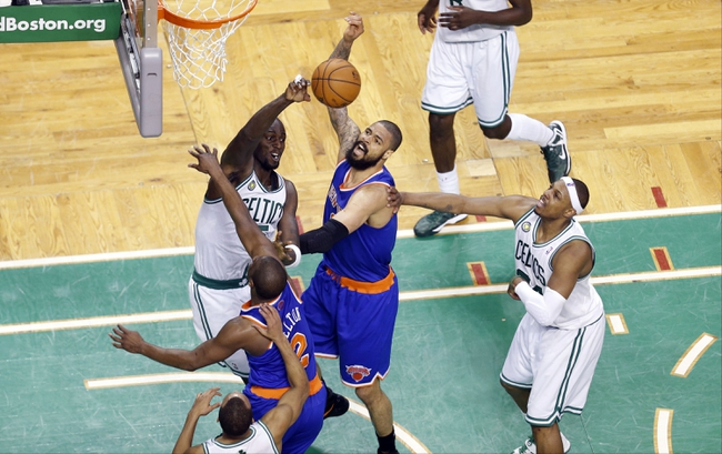 Apr 28, 2013; Boston, MA, USA; New York Knicks center Tyson Chandler (6) works for the rebound against Boston Celtics center Kevin Garnett (5) during the third quarter in game four of the first round of the 2013 NBA playoffs at TD Garden. Mandatory Credit: David Butler II-USA TODAY Sports