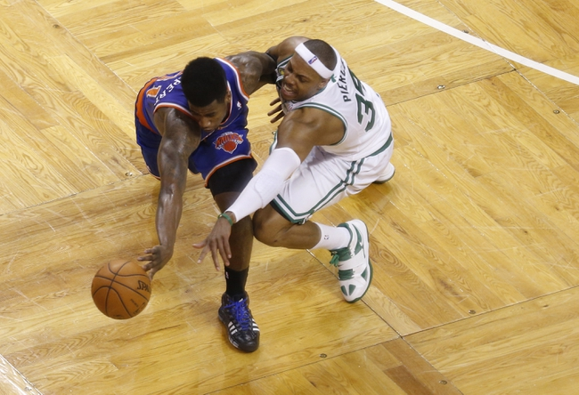 Apr 28, 2013; Boston, MA, USA; Boston Celtics small forward Paul Pierce (34) and New York Knicks small forward Iman Shumpert (21) work for the loose ball during the fourth quarter in game four of the first round of the 2013 NBA playoffs at TD Garden. Mandatory Credit: David Butler II-USA TODAY Sports