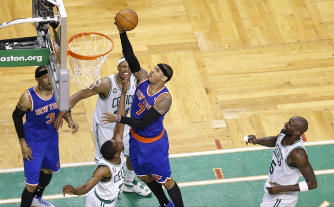 Apr 28, 2013; Boston, MA, USA; New York Knicks small forward Carmelo Anthony (7) drives the ball to the basket against Boston Celtics small forward Paul Pierce (34) during the fourth quarter in game four of the first round of the 2013 NBA playoffs at TD Garden. Mandatory Credit: David Butler II-USA TODAY Sports