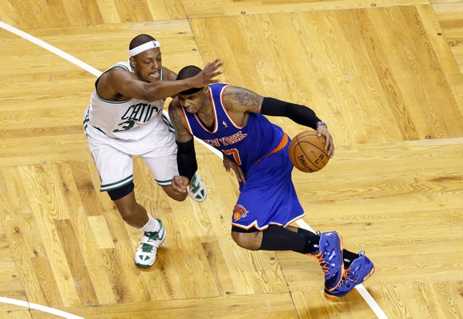 Apr 28, 2013; Boston, MA, USA; New York Knicks small forward Carmelo Anthony (7) drives the ball against Boston Celtics small forward Paul Pierce (34) during overtime in game four of the first round of the 2013 NBA playoffs at TD Garden. The Celtics defeated the New York Knicks 97-90. Mandatory Credit: David Butler II-USA TODAY Sports