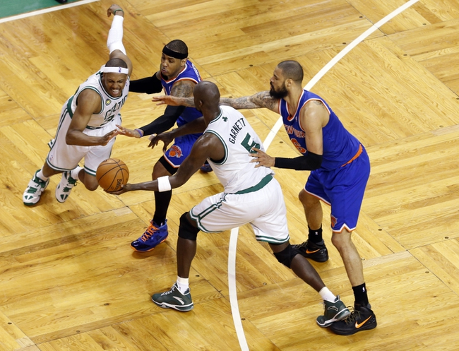 Apr 28, 2013; Boston, MA, USA; Boston Celtics small forward Paul Pierce (34) and Boston Celtics center Kevin Garnett (5) work the ball against New York Knicks small forward Carmelo Anthony (7) and center Tyson Chandler (6)  during the fourth quarter in game four of the first round of the 2013 NBA playoffs at TD Garden. Mandatory Credit: David Butler II-USA TODAY Sports