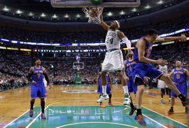 Apr 28, 2013; Boston, MA, USA; Boston Celtics small forward Paul Pierce (34) dunks the ball in the second half against New York Knicks point guard Pablo Prigioni (9) in game four of the first round of the 2013 NBA playoffs at TD Garden. The Celtics defeated the New York Knicks in overtime 97-90. Mandatory Credit: David Butler II-USA TODAY Sports