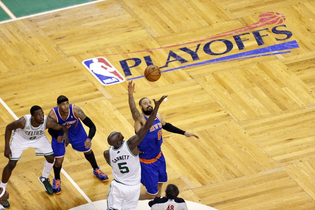 Apr 28, 2013; Boston, MA, USA; New York Knicks center Tyson Chandler (6) and Boston Celtics center Kevin Garnett (5) tip-off for overtime play in game four of the first round of the 2013 NBA playoffs at TD Garden. The Celtics defeated the New York Knicks 97-90. Mandatory Credit: David Butler II-USA TODAY Sports