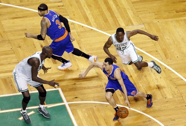 Apr 28, 2013; Boston, MA, USA; New York Knicks point guard Pablo Prigioni (9) drives the ball against Boston Celtics center Kevin Garnett (5) during the fourth quarter in game four of the first round of the 2013 NBA playoffs at TD Garden. Mandatory Credit: David Butler II-USA TODAY Sports