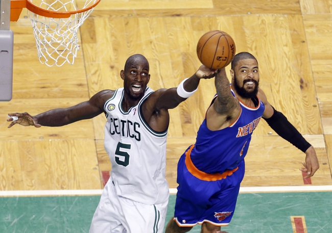 Apr 28, 2013; Boston, MA, USA; Boston Celtics center Kevin Garnett (5) and New York Knicks center Tyson Chandler (6) work for the rebound during overtime in game four of the first round of the 2013 NBA playoffs at TD Garden. The Celtics defeated the New York Knicks 97-90. Mandatory Credit: David Butler II-USA TODAY Sports