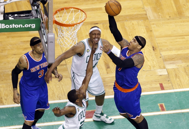 Apr 28, 2013; Boston, MA, USA; New York Knicks small forward Carmelo Anthony (7) shoots against Boston Celtics shooting guard Jordan Crawford (27) during the fourth quarter in game four of the first round of the 2013 NBA playoffs at TD Garden. Mandatory Credit: David Butler II-USA TODAY Sports