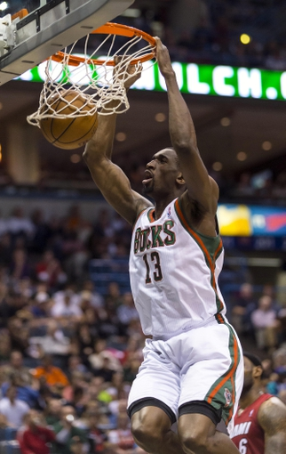 Apr 28, 2013; Milwaukee, WI, USA; Milwaukee Bucks forward Ekpe Udoh (13) dunks during the third quarter of game four of the first round of the 2013 NBA playoffs against the Miami Heat at the BMO Harris Bradley Center.  Miami won 88-77.  Mandatory Credit: Jeff Hanisch-USA TODAY Sports