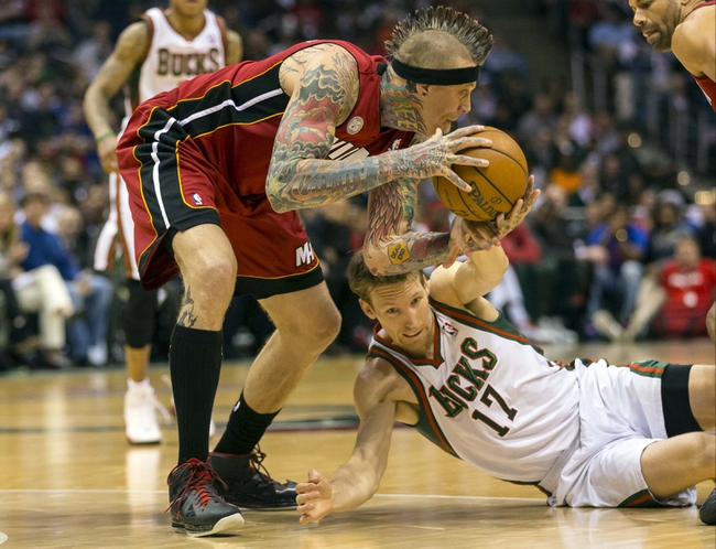 Apr 28, 2013; Milwaukee, WI, USA; Miami Heat forward Chris Andersen (11) picks up the loose ball as  Milwaukee Bucks forward Mike Dunleavy reaches out during the fourth quarter of game four of the first round of the 2013 NBA playoffs at the BMO Harris Bradley Center.  Miami won 88-77.  Mandatory Credit: Jeff Hanisch-USA TODAY Sports
