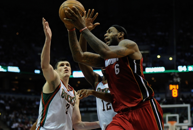 Apr 28, 2013; Milwaukee, WI, USA; Miami Heat forward LeBron James drives for a layup against Milwaukee Bucks forward Ersan Ilyasova in game four of the first round of the 2013 NBA playoffs at the BMO Harris Bradley Center. Mandatory Credit: Benny Sieu-USA TODAY Sports