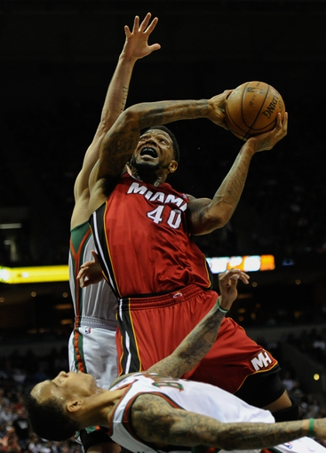 Apr 28, 2013; Milwaukee, WI, USA; Miami Heat forward Udonis Haslem goes for a layup against Milwaukee Bucks guard Monta Ellis in game four of the first round of the 2013 NBA playoffs at the BMO Harris Bradley Center. Mandatory Credit: Benny Sieu-USA TODAY Sports