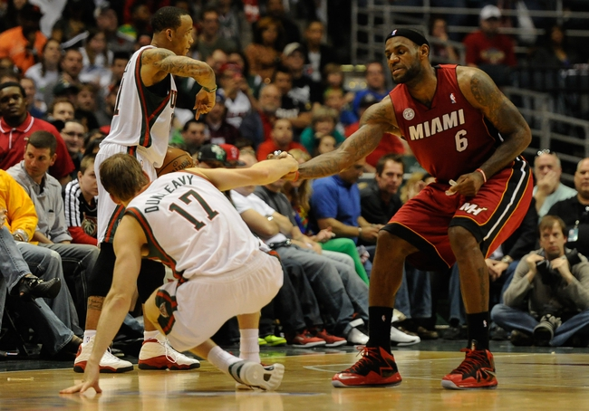 Apr 28, 2013; Milwaukee, WI, USA; Miami Heat forward LeBron James helps Milwaukee Bucks forward Mike Dunleavy get up in game four of the first round of the 2013 NBA playoffs at the BMO Harris Bradley Center. Mandatory Credit: Benny Sieu-USA TODAY Sports