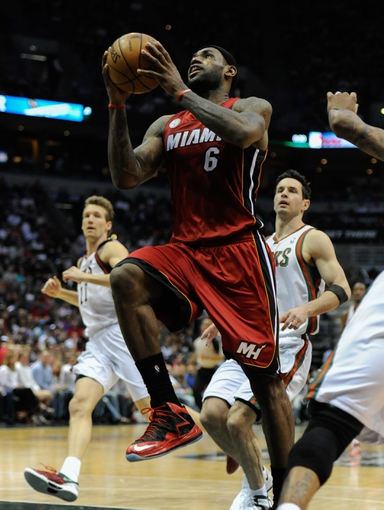 Apr 28, 2013; Milwaukee, WI, USA; Miami Heat forward LeBron James scores a basket against the Milwaukee Bucks in game four of the first round of the 2013 NBA playoffs at the BMO Harris Bradley Center. Mandatory Credit: Benny Sieu-USA TODAY Sports