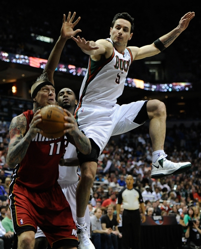 Apr 28, 2013; Milwaukee, WI, USA; Milwaukee Bucks guard J.J. Redick tries to block a shot by Miami Heat forward Chris Andersen in game four of the first round of the 2013 NBA playoffs at the BMO Harris Bradley Center. Mandatory Credit: Benny Sieu-USA TODAY Sports