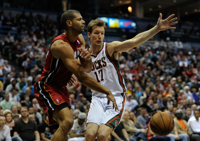 Apr 28, 2013; Milwaukee, WI, USA; Miami Heat forward Shane Battier gets a pass away from Milwaukee Bucks forward Mike Dunleavy in game four of the first round of the 2013 NBA playoffs at the BMO Harris Bradley Center. Mandatory Credit: Benny Sieu-USA TODAY Sports