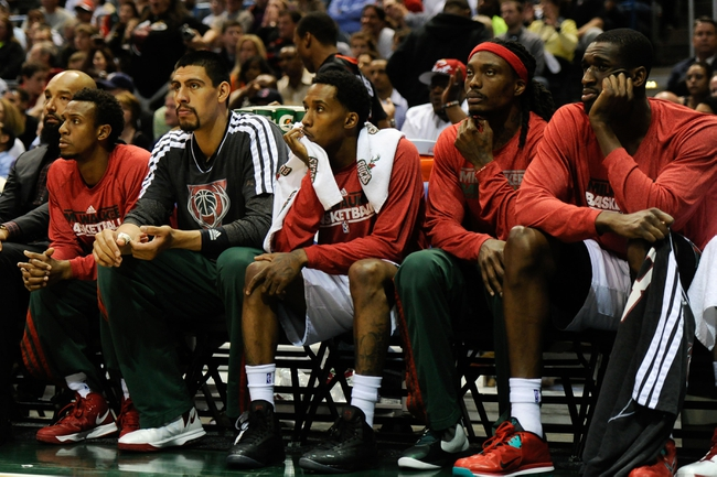 Apr 28, 2013; Milwaukee, WI, USA; The Milwaukee Bucks watch the final minutes of game four in the first round against the Miami Heat of the 2013 NBA playoffs at the BMO Harris Bradley Center. The Heat beat the Bucks 88-77 to complete a four game sweep.  Mandatory Credit: Benny Sieu-USA TODAY Sports
