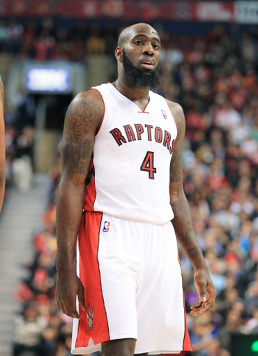 Apr 17, 2013; Toronto, Ontario, CAN; Toronto Raptors small forward Quincy Acy (4) during the game against the Boston Celtics at the Air Canada Centre. The Raptors beat the Celtics 114-90. Mandatory Credit: Kevin Hoffman-USA TODAY Sports
