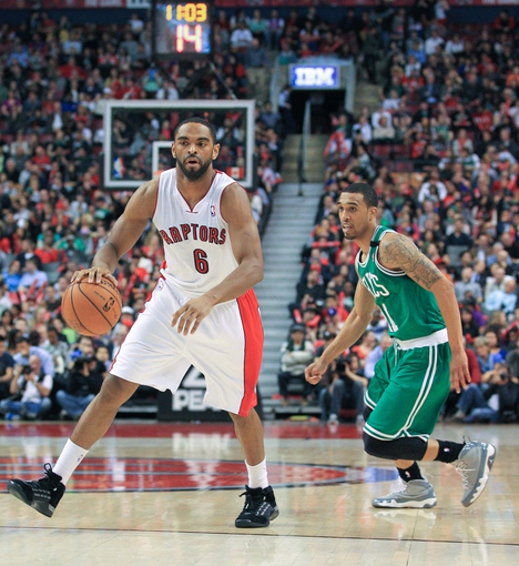 Apr 17, 2013; Toronto, Ontario, CAN; Toronto Raptors shooting guard Alan Anderson (6) and Boston Celtics shooting guard Courtney Lee (11) during the game at the Air Canada Centre. The Raptors beat the Celtics 114-90. Mandatory Credit: Kevin Hoffman-USA TODAY Sports