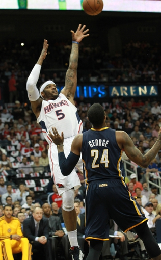 Apr 29, 2013; Atlanta, GA, USA; Atlanta Hawks forward Josh Smith (5) over Indiana Pacers guard Paul George (24) in game four of the first round of the 2013 NBA playoffs at Philips Arena. Mandatory Credit: Marvin Gentry-USA TODAY Sports