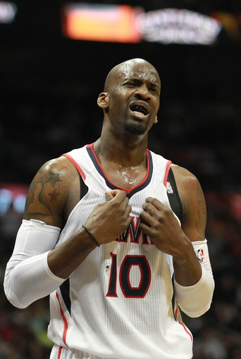 Apr 29, 2013; Atlanta, GA, USA; Atlanta Hawks center Johan Petro reacts to a foul called on him during the first half of game four of the first round of the 2013 NBA playoffs at Philips Arena. Mandatory Credit: Marvin Gentry-USA TODAY Sports
