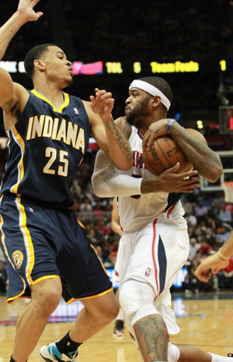 Apr 29, 2013; Atlanta, GA, USA; Atlanta Hawks forward Josh Smith (5) controls the ball against Indiana Pacers forward Gerald Green in game four of the first round of the 2013 NBA playoffs at Philips Arena. Mandatory Credit: Marvin Gentry-USA TODAY Sports