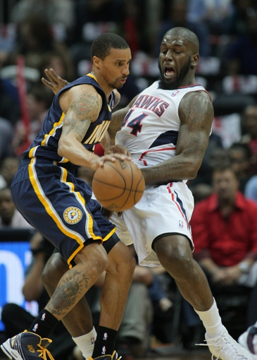 Apr 29, 2013; Atlanta, GA, USA; Atlanta Hawks forward Ivan Johnson (44) gets away from Indiana Pacers guard George Hill (3)  in game four of the first round of the 2013 NBA playoffs at Philips Arena. Mandatory Credit: Marvin Gentry-USA TODAY Sports