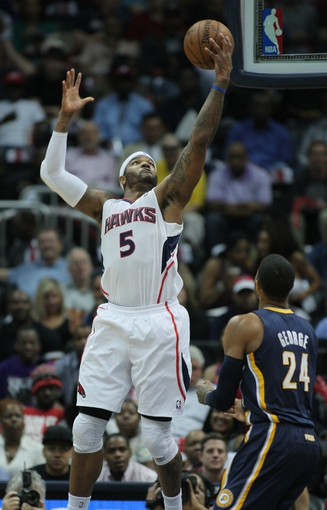 Apr 29, 2013; Atlanta, GA, USA; Atlanta Hawks forward Josh Smith (5) grabs a rebound against the Indiana Pacers in game four of the first round of the 2013 NBA playoffs at Philips Arena. Mandatory Credit: Marvin Gentry-USA TODAY Sports